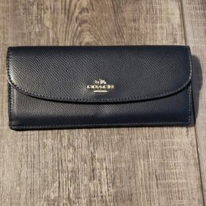 Navy blue leather Coach wallet.